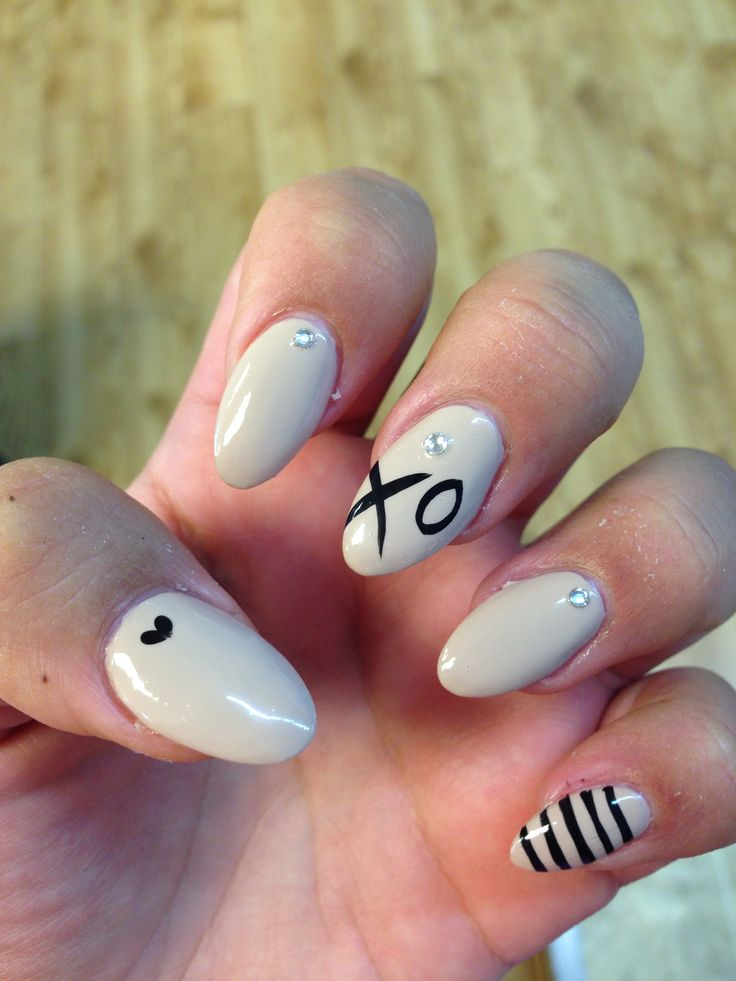 Almond shaped beige nails with design