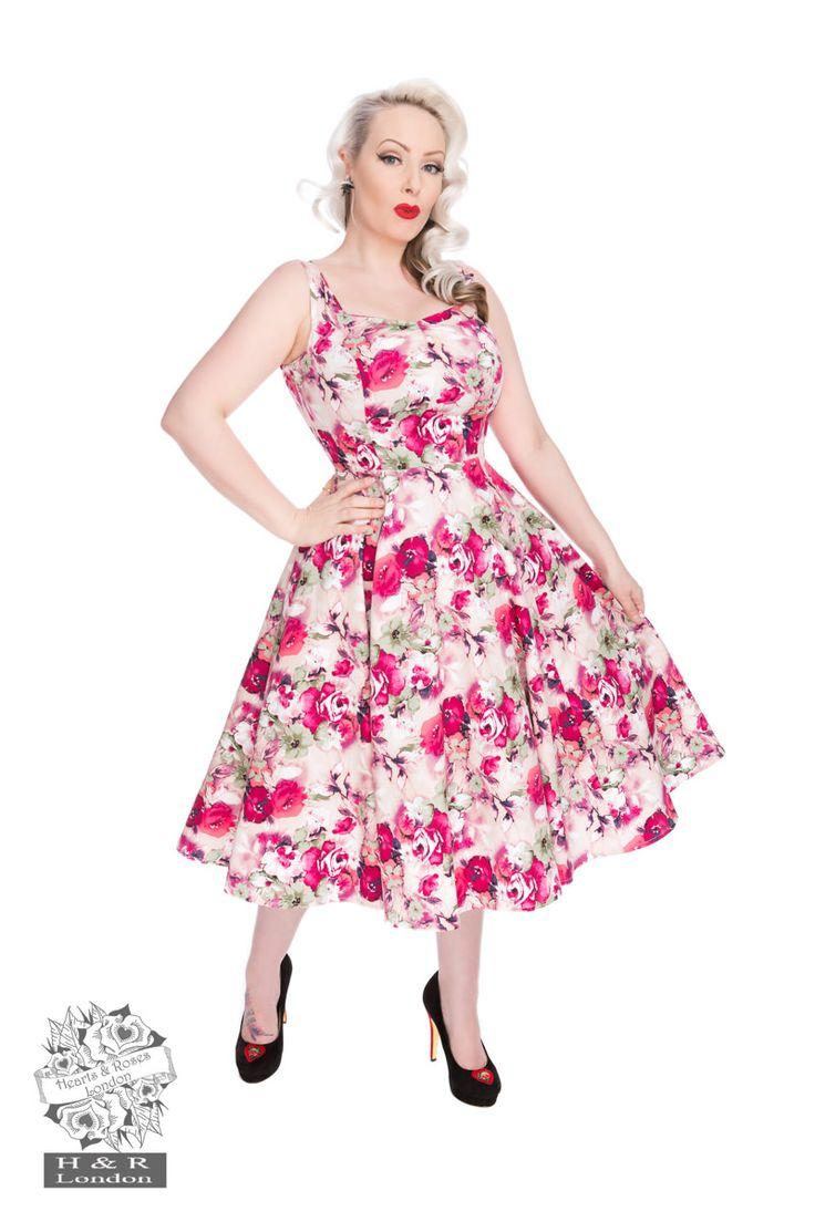 Robe rétro rose thé avec motifs floraux, sans manche, décolleté carré devant et jeu de croisillons pour le décolleté dos, bas ample  97%coton et 3% élasthan