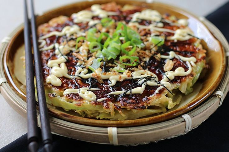 """Savoury and satisfying, these Japanese pancakes are a simple, frugal meal with just a few ingredients. Frugal can still be fabulous, as i'm showing you this week. Okonomiyaki are Japanese savoury pancakes, sometimes referred to as Japanese pizza. The name comes from the word okonomi, meaning """"what you like"""" or """"what you want"""", and yakiRead More »"""