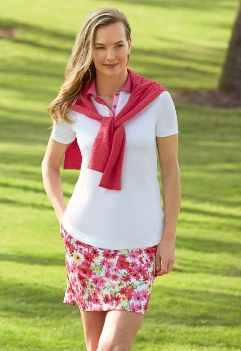 White/Floral Greg Norman Ladies Golf Outfits (Shirt & Skort). Find the best ladies apparel at #lorisgolfshoppe