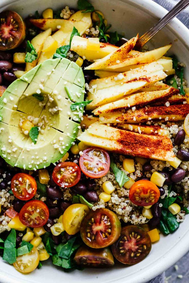 Chili Mango Zesty Quinoa Salad! This summertime salad is perfect for eating by the pool or taking to work! Refreshing, gluten-free, and vegan!