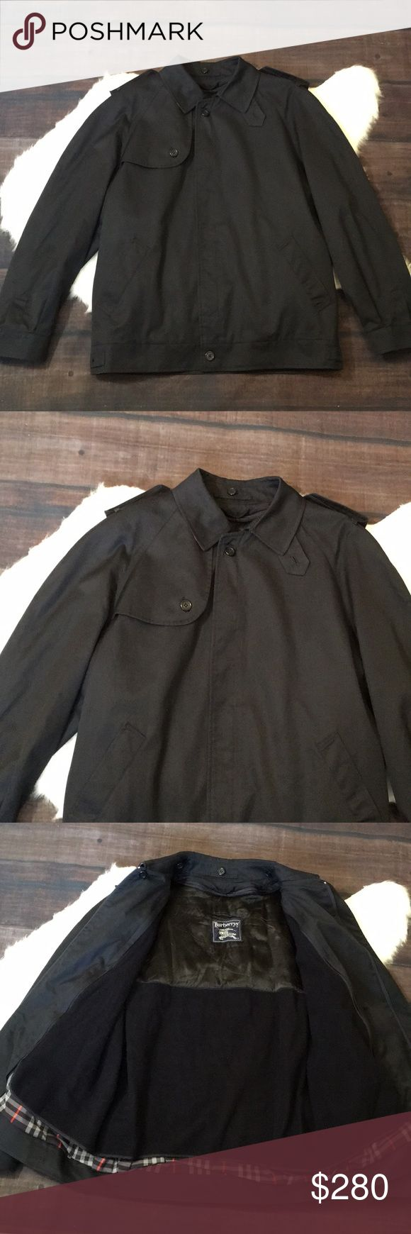 Burberry bomber style jacket Excellent condition 9/10  It is a dark navy blue/black color Burberry Jackets & Coats