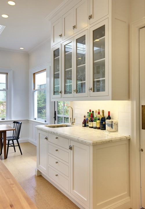 Cambria Torquay countertop, white cabinets, white subway tile backsplash - very clean look.
