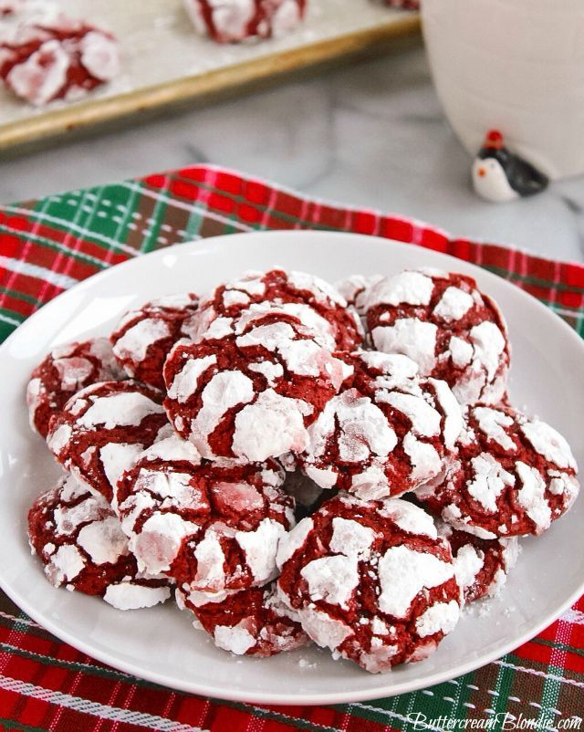 Red Velvet Crinkle Cookies - Classic crinkle cookies get a sweet update with red velvet! Chewy, crackly and festive, red velvet crinkles are perfect for the holidays!   ButtercreamBlondie.com
