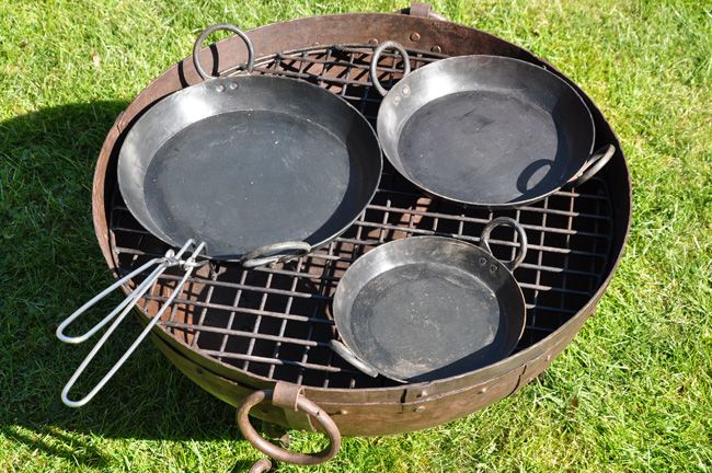 Set of 3 Skillets plus Handle - Kadai - These Skillets are really versatile, made from heavy steel they are ideal for al fresco cooking or for use within the home.  They are great for barbequeing food that cannot go straight onto a grill i.e. vegetables and fish