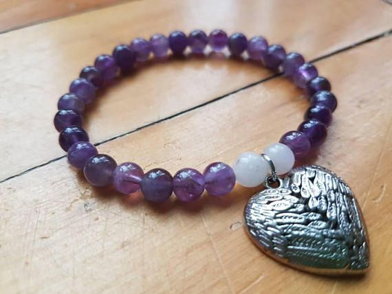 Check out this item in my Etsy shop https://www.etsy.com/ca/listing/558416428/natural-amethyst-bead-bracelet-womens