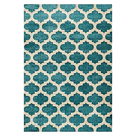 Oceanic style and exotic design make the Antique Blue Lattice Modern Rug from Rug Republic a calming and comfortable addition to your contemporary space.