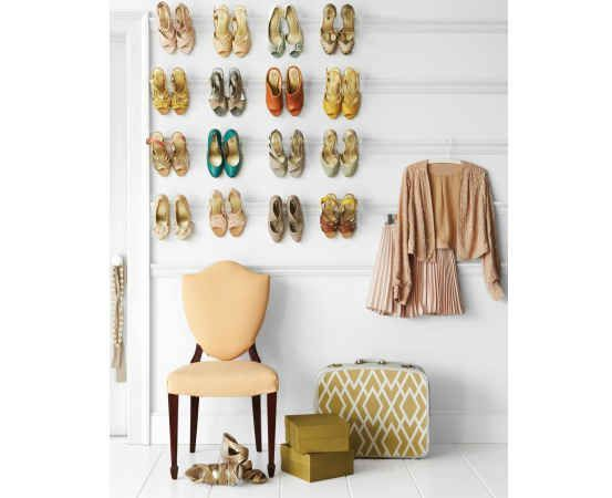 Love your pretty heels? Display (and organize 'em) with a picture rail shoe rack. | 53 Seriously Life-Changing Clothing Organization Tips