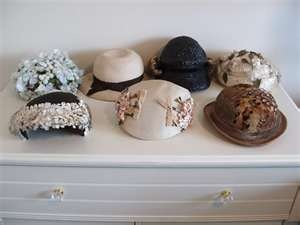 I have a few vintage hats, a couple I have worn in plays.  Wish that style would come back so I had a place to wear them now!