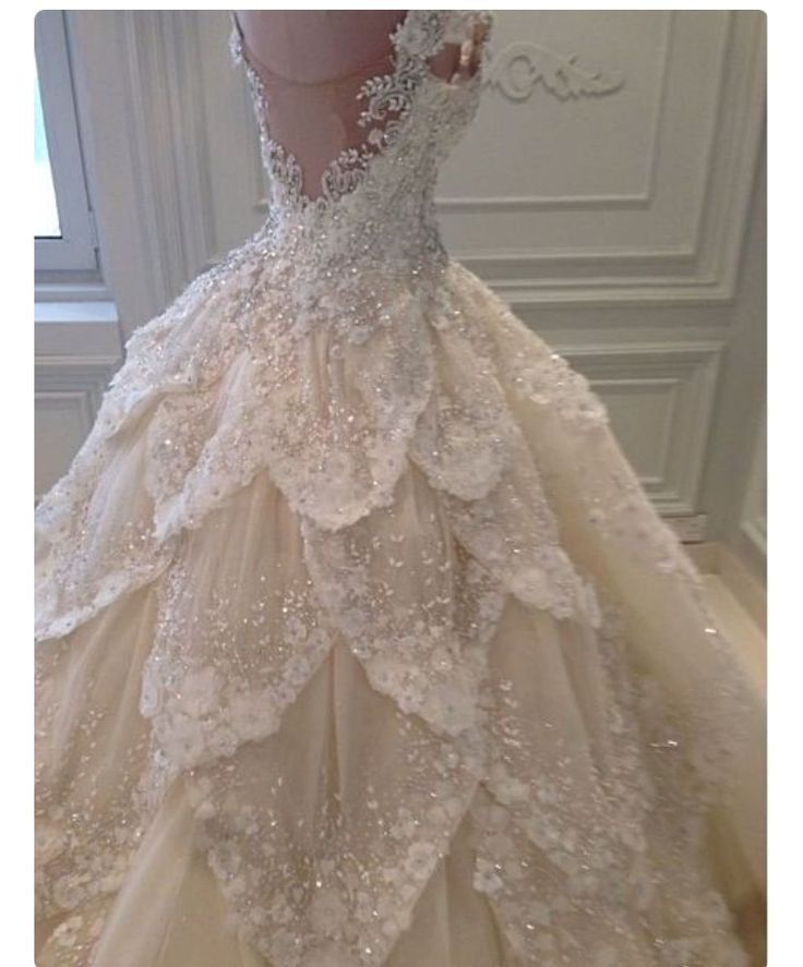 Just had to pin it because... It's a flower fairy wedding dress with a petal skirt! Whomever wears this dress will revert to floating down the aisle, as opposed to walking.