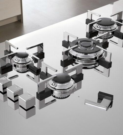 Placa integrada de Cata (España) con Soportes imantados que se pueden remover para hacer limpieza.