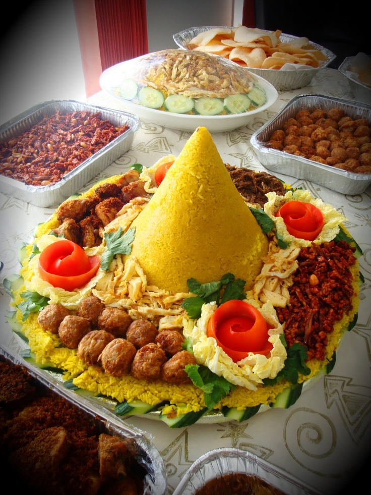 Tumpeng - National dish of Indonesia. Cone-shaped rice with fried chicken, sweet…