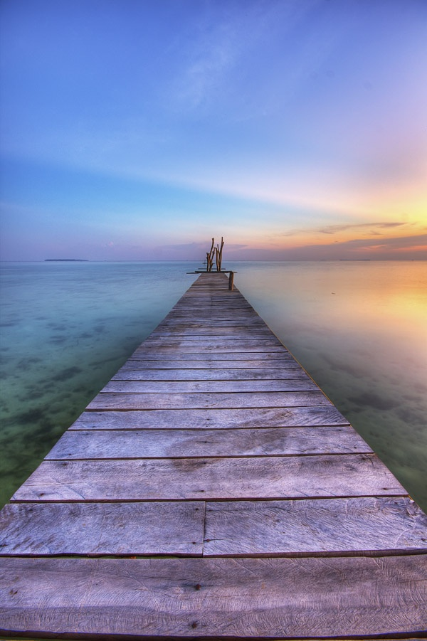 A wooden jetty against the blue of the water, Karimun Jawa