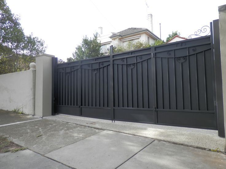 Bi-fold Trackless Automatic Gates - The Motorised Gate Company