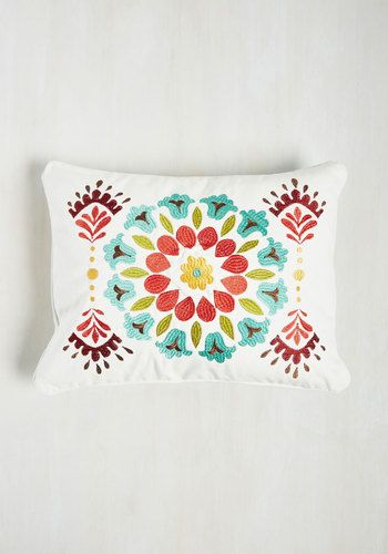 You must have lounged on your love seat a thousand times, but no respite was as restful as it is with this white pillow cushioning your recline! Heartbreakingly haute with its teal, green, red, and yellow, folksy embroidery, this canvas throw is quite comforting - and that's no secret.