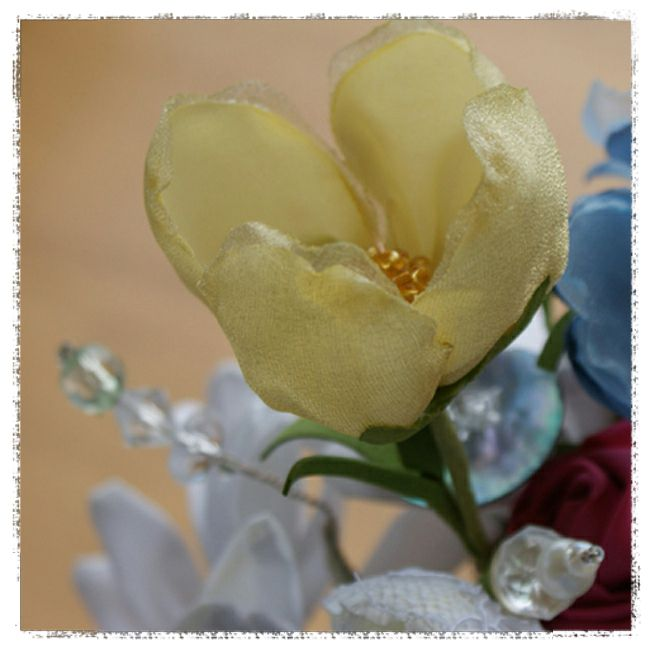 wedding bouquet for Michelle - Welsh poppy in pale yellow satin overlaid with gold georgette and a covered and beaded button for the centre