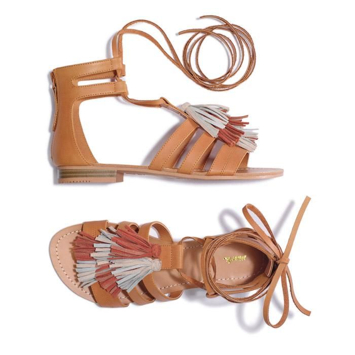 mark. By Avon Walking Tour Sandals. Real suede tassels! The perfect summer shoe for a night out on the beach or a stroll through town. These are both comfortable and fashionable!  FEATURES• Laces wrap around to go up leg• 3 faux leather straps over the toe and upper• Back zippers for easy on and off• Open toe  MATERIALSUpper: PU (Polyurethane) Sock: PU (Polyurethane) Outsole: TPR (Thermal Plastic Rubber).  Made in China.