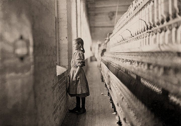 """""""The Mill: A moment's glimpse of the outer world. [She] said she was 11 years old [and had] been working over a year. Rhodes Mfg. Co. Lincolnton, North Carolina."""""""