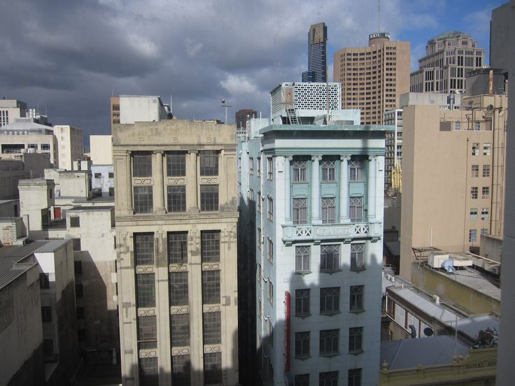 Two Art Deco buildings in Bourke Street, Melbourne, opposite the Myer building. The one on the right is Deva House built in 1924, designed by Harry Norris.  This nine-storey reinforced concrete building was originally a Coles store.