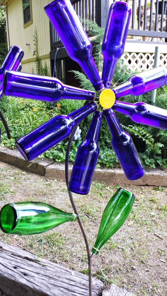 Garden art, blue bottles flower and green bottles as leaves; recycled; Original by LakeLureBeadShop; Upcycle, Recycle, Salvage, diy, thrift, flea, repurpose! For vintage ideas and goods shop at Estate ReSale & ReDesign, Bonita Springs, FL