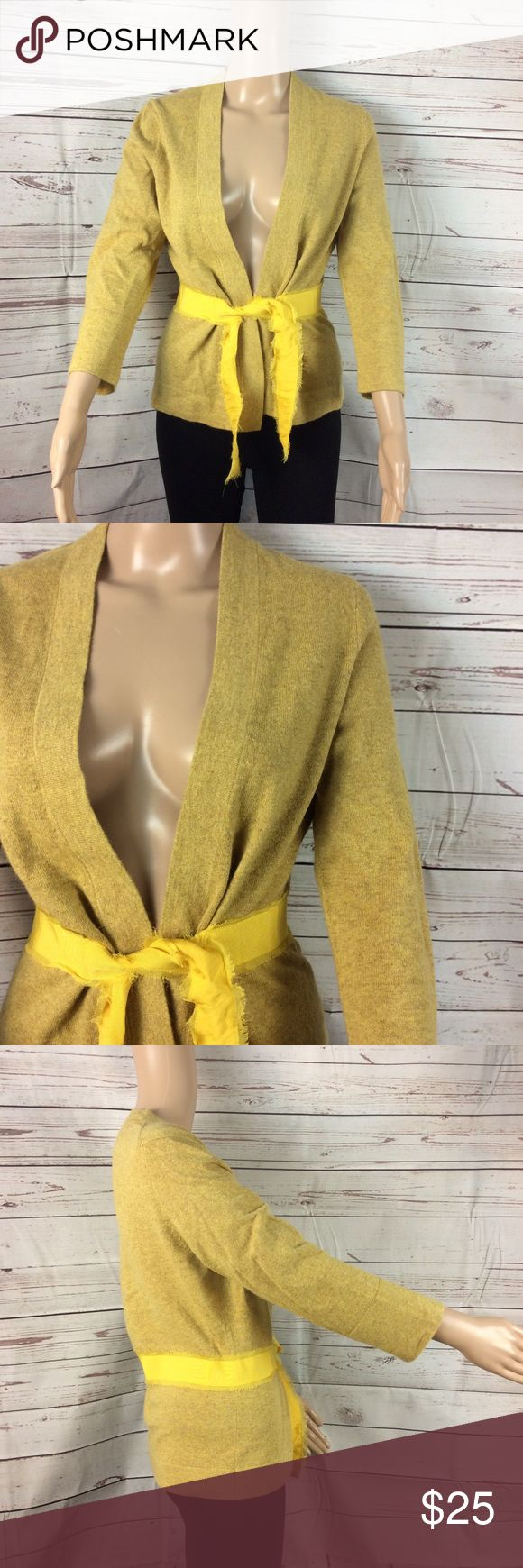 J.crew Harvest gold cardigan w/ribbon belt detail J.crew harvest gold cardigan with yellow ribbon detail Attached ribbon belt with raw edge detail Wide cuff Three-quarter sleeve Wool blend Size large Link from top to bottom 23 inches Armpit to armpit 17 inches Arm length 19 inches This is a preowned item in good preowned condition J. Crew Sweaters Cardigans