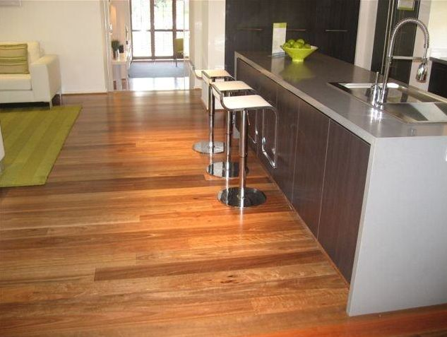 A timber floor is an ever-changing piece of art. Look at how the various forms of natural and artificial light bring out the warm orange bias. Your floor will look great in different ways all day and night.