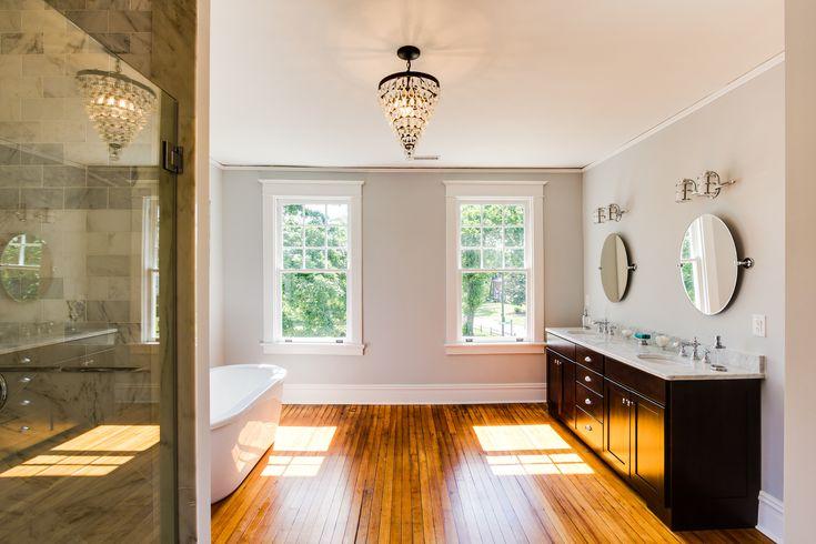 (Hawthorne) spacious open bathroom with wood floor, painted in Benjamin Moore O-Zone Blue @Remodelaholic