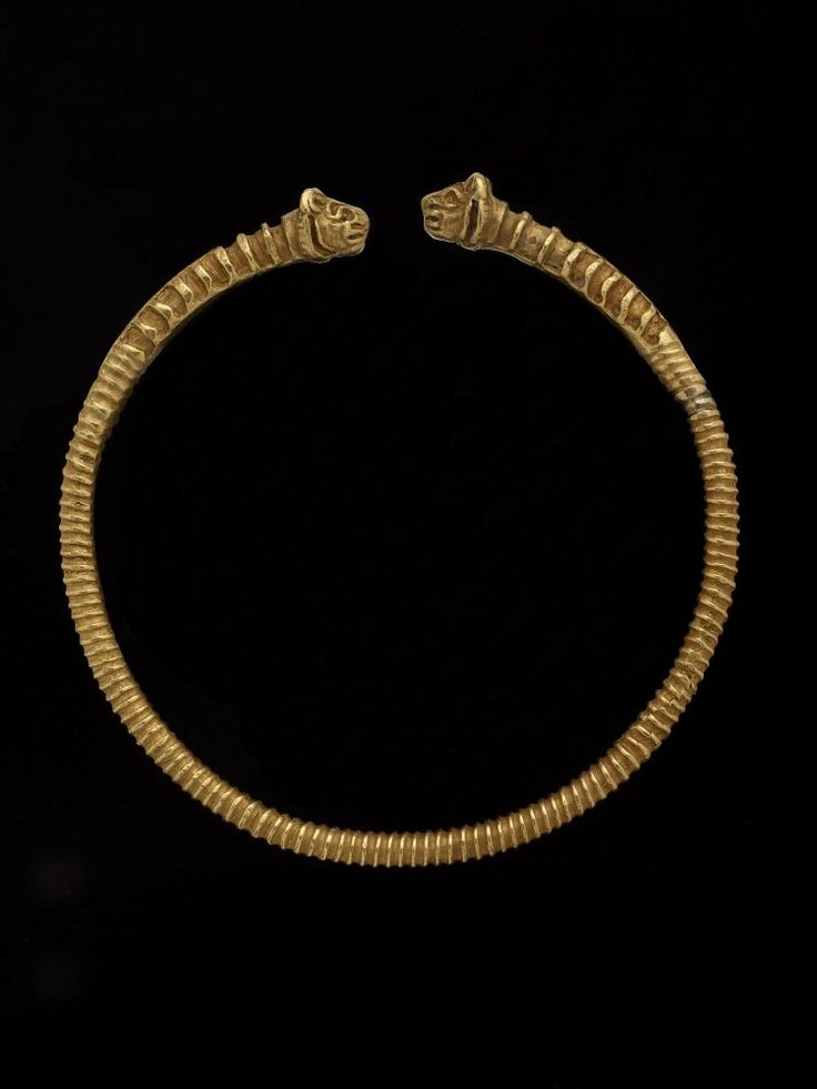 Oxus Treasure; armlet; Achaemenid; 5thC BC-4thC BC; Takht-i Kuwad. Ribbed gold penannular armlet: with lion's head terminals; slender hoop transversely ribbed; lions' manes indicated by originally inlaying into a series of rectangular cells cut into the metal.