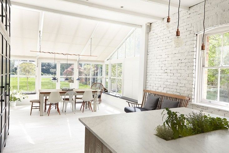 London Victorian, White Expansive Open Kitchen conservatory extension. Direct Access to Garden | Remodelista