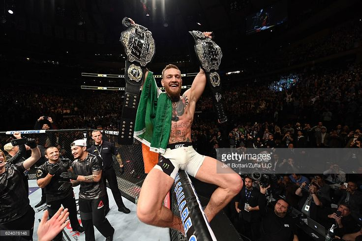 UFC lightweight and featherweight champion Conor McGregor of Ireland celebrates after defeating Eddie Alvarez in their UFC lightweight championship fight during the UFC 205 event at Madison Square Garden on November 12, 2016 in New York City.