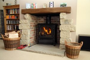 wood burning stove...I love the idea of putting inside a fireplace...although, would that affect the way heat is dispersed in the house?