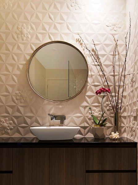 Very elegant powder room features bisazza tiles,cabinetry lighting, featured mirror, glass pendant and laufen.  Timeless bathroom. Credits to Matthew Mallet Photograpy
