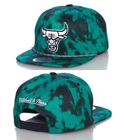 MITCHELL AND NESS Tie dye Miami Heat snapback cap NBA Basketball Adjustable strap on back Embroidered team logo on front All-over tie dye print