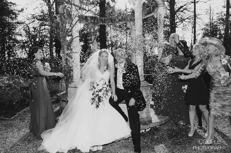 Guests throw confetti at the bride & groom. Weddings at Killashee House Hotel photographed by Couple Photography.