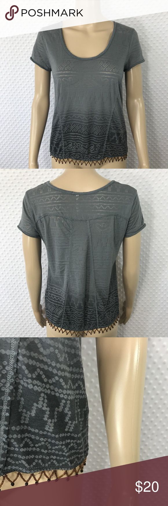 Free People Beaded Top Gray Short Sleeve Boho Item: Free People Beaded Top Gray Short Sleeve Boho Loose Tribal Shirt Sz Extra Small  Size: Extra Small  Refer to measurements below for accurate fit!  Measured flat:   17       inches armpit to armpit  1       inches armpit to the end of the sleeve  19       inches from collar seam to shirttail         Base Color:  Gray   Fabric: Cotton, Polyester  Please look at photos for better description Free People Tops Blouses