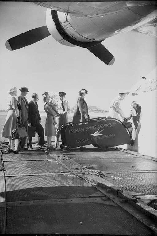 Passengers embarking a TEAL flying boat destined for Sydney at Wellington New Zealand 1940s