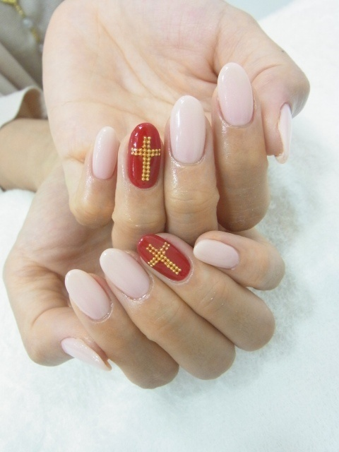 nude nails; red cross accent