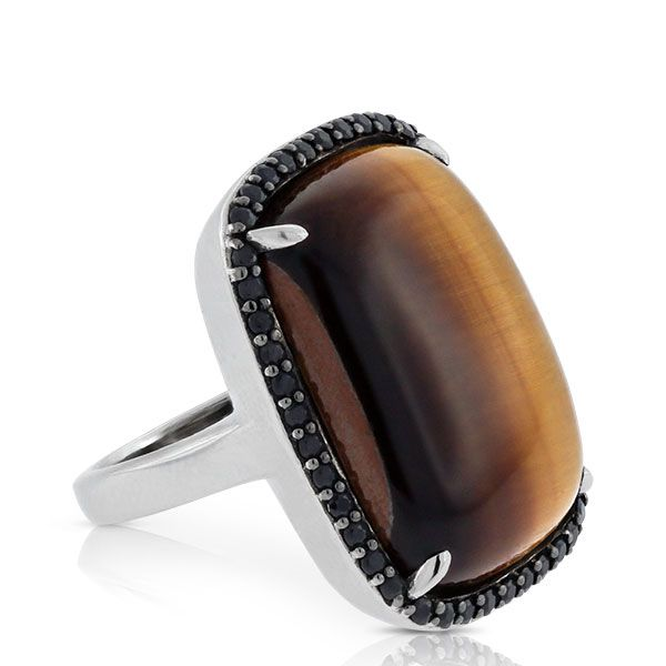 Lisa Bridge statement ring with spectacular golden brown tiger's eye framed by a sparkling halo of black sapphires.