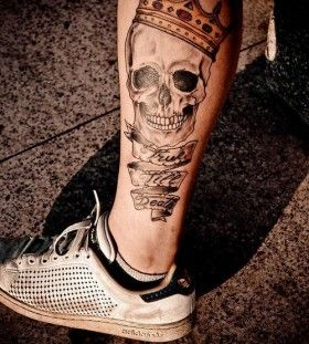 Skull and quote crown tattoo