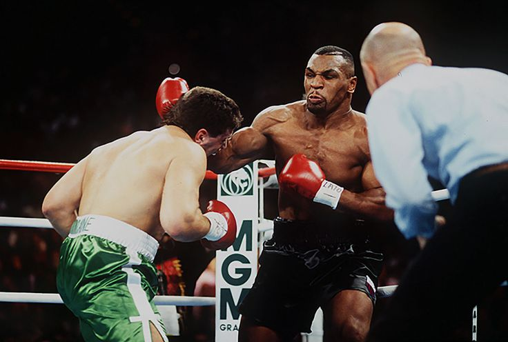 "Mike Tyson pounds a helpless Peter McNeeley on Aug. 19, 1995 at the MGM Grand in Las Vegas. Billed as ""He's Back,"" the bout marked the return of Tyson to professional boxing after over four years away due to his 1991 arrest and subsequent conviction for rape in 1992 which led to ""Iron Mike"" serving three years in prison. Tyson won the fight after just 89 seconds. (John Iacono for SI)GALLERY: Rare Photos of Mike Tyson"