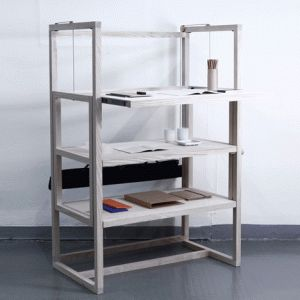 A Shelf of Tables is three desks  in one shelving unit, suitable for wheel-chair users.