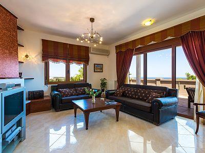 Rethymno villa rental - The living room has direct access to the veranda.