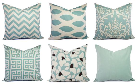 This listing is for two spa blue and beige pillow covers! These decorative pillow covers fit a 16 x 16 inch pillow insert and are 100% cotton.
