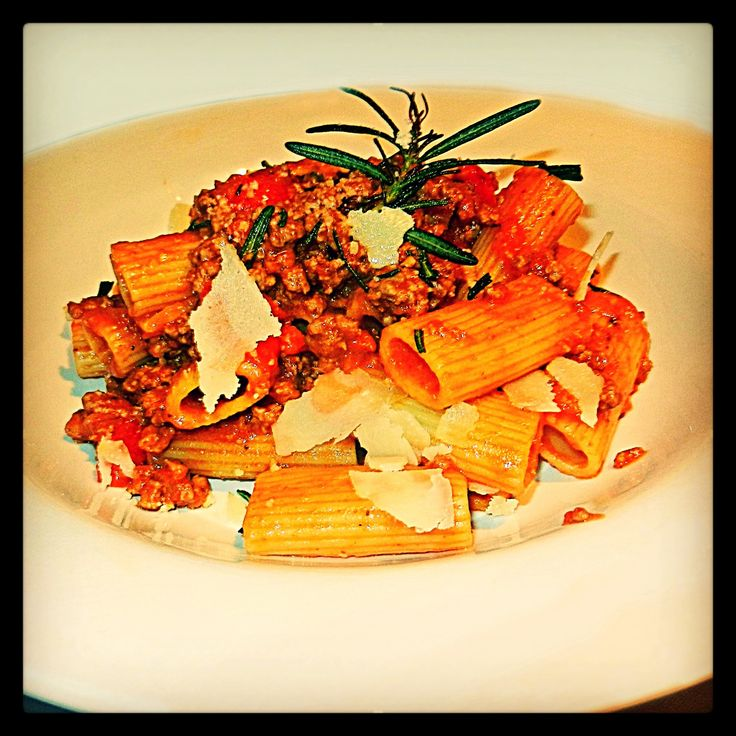 Lamb La Bamba: Deliciously rich and meaty lamb ragout combined with rigatoni pasta, fresh tomatoes, fresh basil, oregano & Parmesan shavings.
