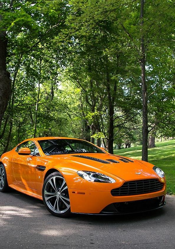 Orange Aston Martin                                                                                                                                                                                 Plus