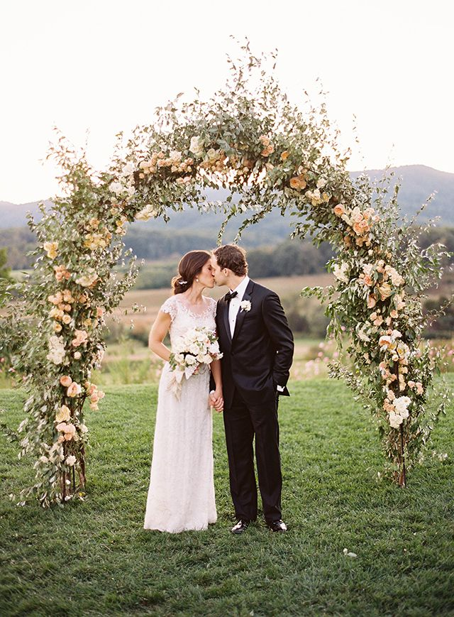 October Wedding in Virginia at Pippin Hill - Peach Floral Arch created by Ariella Chezar.