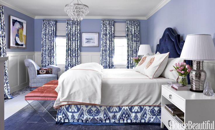 In the master bedroom, the palette is classic blue and white with a touch of salmon pink.