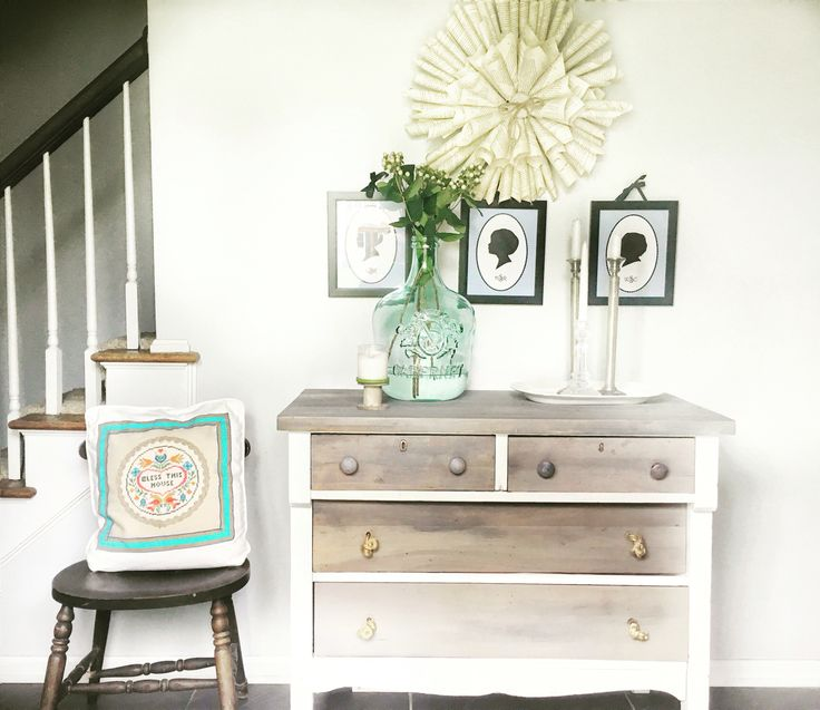 Driftwood painted empire dresser with glass demijohn. https://www.facebook.com/Thepaintedcrowe/