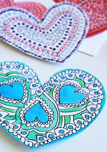 Adorable and simple Valentines using just markers, water colors, and puffy paint on construction paper.