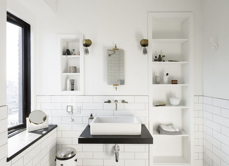 The black-and-white bathroom has a Duravit sink and nickel faucet. It's most asked-about detail is theKPH Mirror, which Camilla carried on a plane with her from Copenhagen (it's also available from Garde in LA). She uses Lyngby Vases as toothbrush holders, and not surprisingly, keeps a Vipp Pedal Bin.